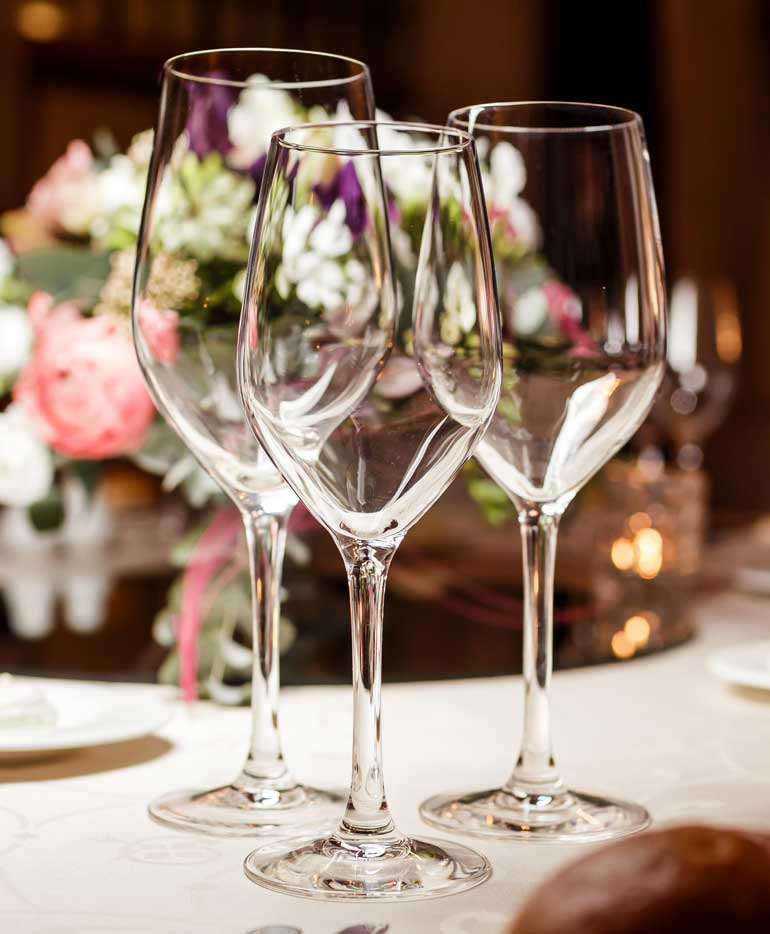 Restaurant table setting with wine glasses